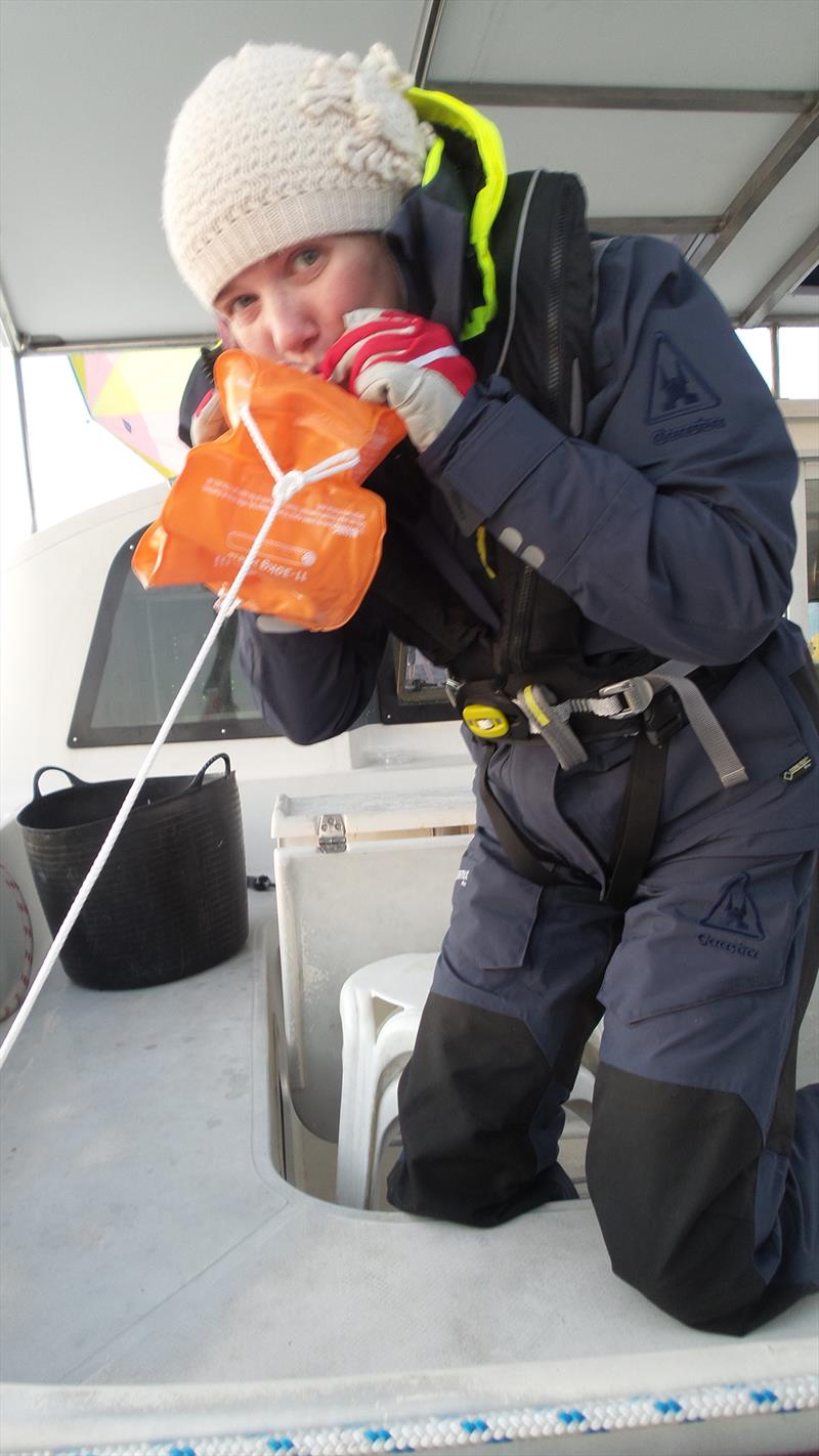 Blowing up the float to hold the plankton net at the surface - photo © Mission Ocean