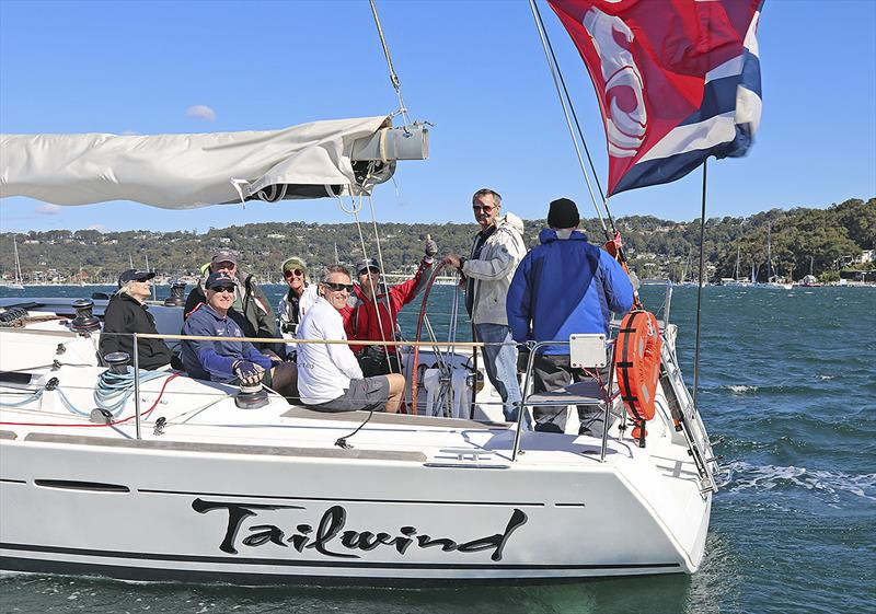 The enthusiastic crew of Tailwind, and that massive Beneteau backstay flag… - photo © John Curnow