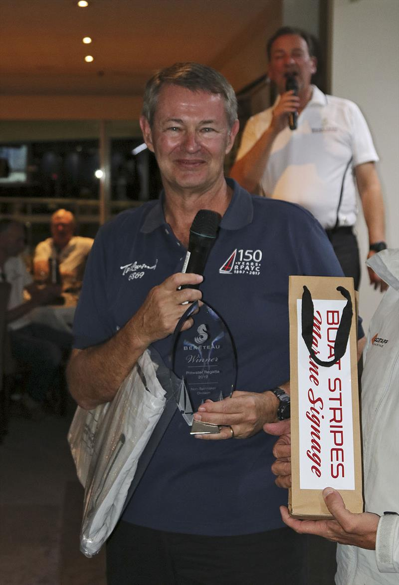 Shaw Russett with some of the loot he collected for Taliwind's win in the Non-Spinnaker Division. - photo © John Curnow