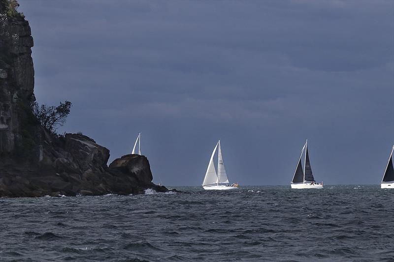 The fleet heads around Lion Island at what was possibly the worst part of the day, weather wise. - photo © John Curnow