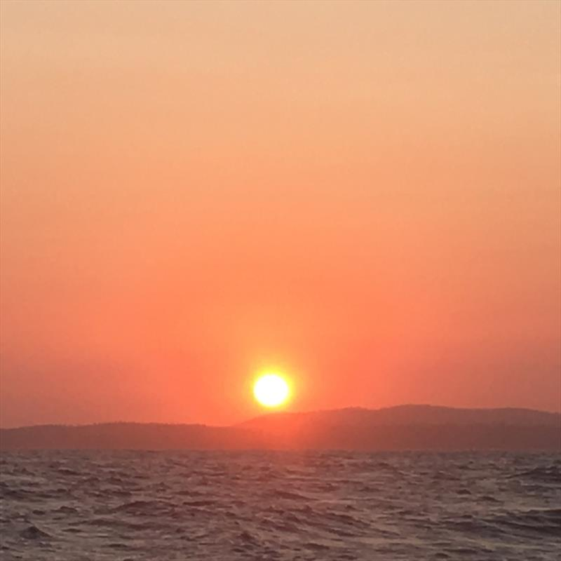 Who could ever tire of these sunsets at sea? Enjoying a stunning evening before our first pitch black bar crossing - photo © Kristen Anderson