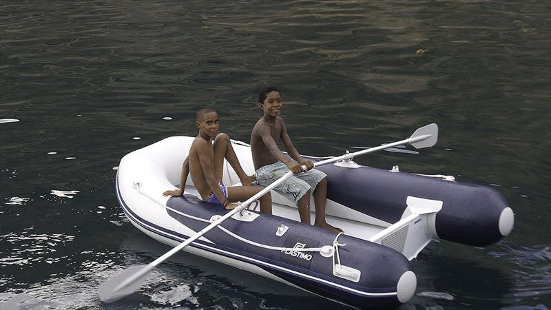 Local kids having fun in our Plastimo tender - easier to row than a wooden fishing boat! - photo © Mission Océan