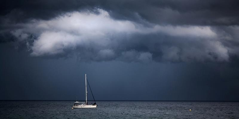 A sailboat in stormy conditions. Don't let this happen to you: Check the marine weather forecast before you depart, and carry a weather radio while on the water - photo © iStock