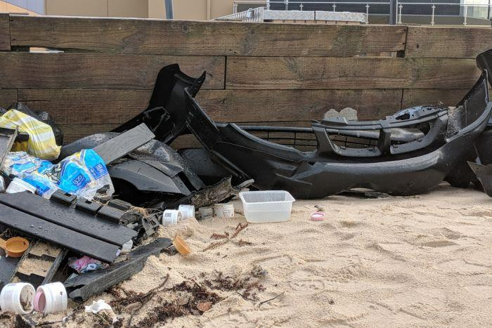 Debris from Liberian ship YM Efficiency washed up north of Newcastle. The ship lost part of its cargo during stormy weather last week. - photo © ABC News: Nancy