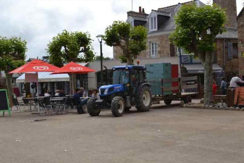 Tractors delivering stores from the ferry to the town - photo © SV Red Roo