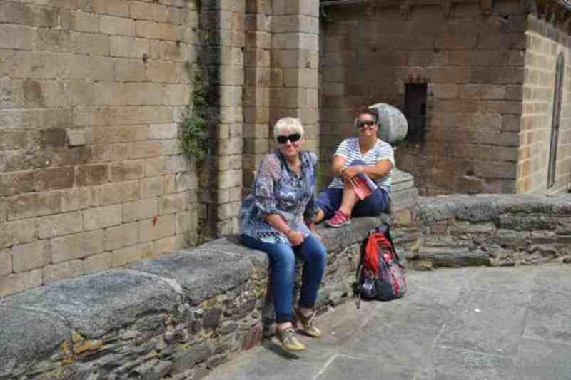 Kris and Maree in Betanzos outside one of the many churches - photo © SV Red Roo