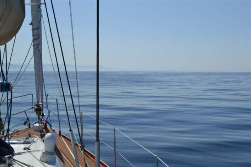 Contrast to earlier passages, a flat calm sea = motoring - photo © SV Red Roo