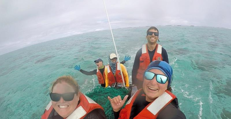 The `Furious Five` with a load of debris and derelict fishing nets aboard our small boat - photo © NOAA Fisheries