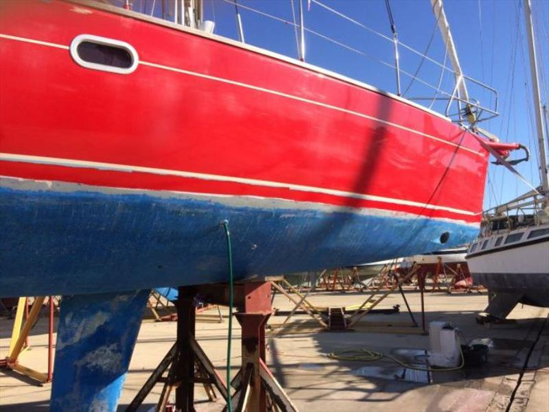 New waterline red – Masking tape still on photo copyright SV Red Roo taken at  and featuring the Cruising Yacht class