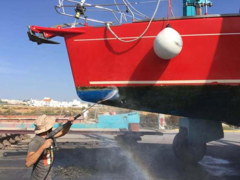 High pressure wash to clean the growth off the hull photo copyright SV Red Roo taken at  and featuring the Cruising Yacht class