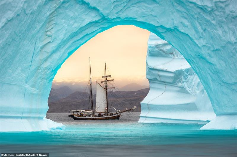 A photographer captured the moment a fishing boat was beautifully framed by a gigantic archway of ice off the coast of Greenland  photo copyright James Rushforth taken at  and featuring the Cruising Yacht class