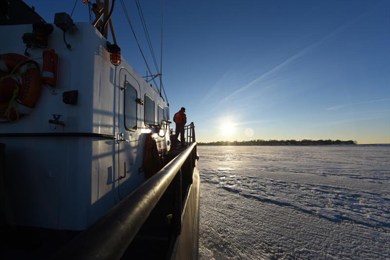The crew of Coast Guard Cutter Shackle, a 65-foot Small Harbor Tug, breaks ice Wednesday, Jan. 10, 2018 near Logan International Airport in Boston Harbor. Shackle is capable of breaking up to 12 inches of ice. photo copyright Petty Officer 3rd Class Andrew Barresi taken at  and featuring the Cruising Yacht class