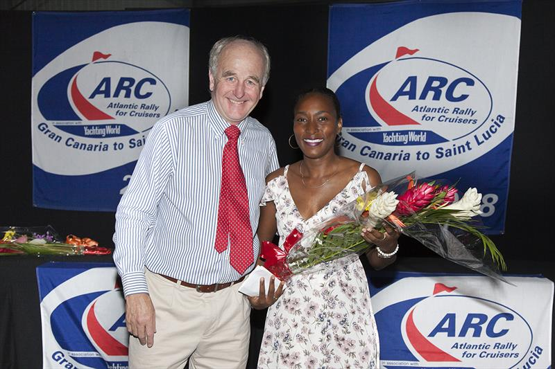 2018 ARC - Prize-giving - World Cruising Club's Managing Director Andrew Bishop with Tessa Joseph of the Events Company Saint Lucia.  photo copyright Clare Pengelly taken at  and featuring the Cruising Yacht class