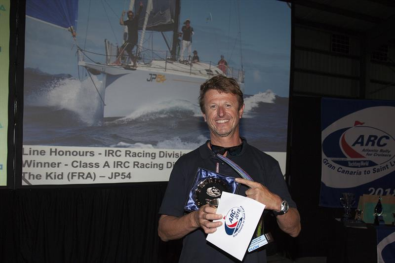 2018 ARC - Prize-giving - Line Honours for the Racing Division and winner of Class A at the Prizegiving Ceremony was French sailing legend JP Dick and his crew from The Kid.  photo copyright Clare Pengelly taken at  and featuring the Cruising Yacht class