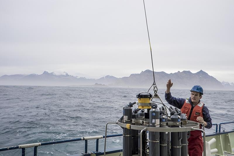 WHOI Postdoctoral researcher Nick Foukal helps deploy an instrument package that takes physical measurements of the water column off the coast of Greenland from aboard the R/V Knorr. photo copyright Carolina Nobre, Woods Hole Oceanographic Institution taken at  and featuring the Cruising Yacht class
