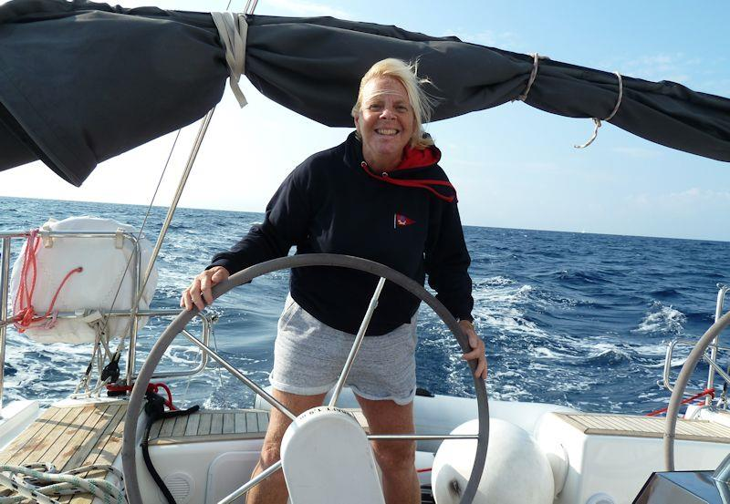 Cruising in Croatia - The author at the helm photo copyright Liz Potter taken at  and featuring the Cruising Yacht class