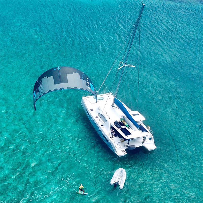 Kiteboarding whilst at anchor - photo © Sailing Wildside