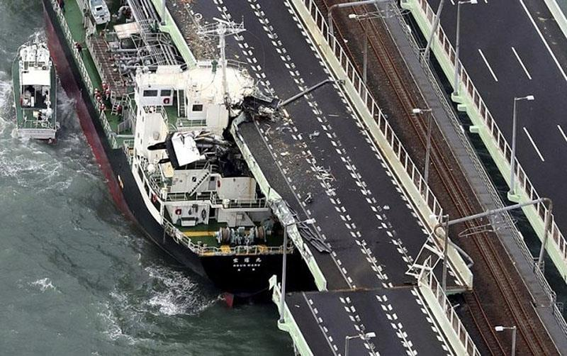 Coastal oiler slams into bridge to Osaka airport. - photo © AP