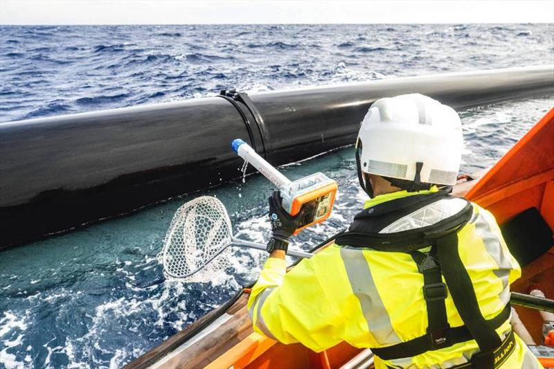 A crew member retrieves a GPS drifter from the water. - photo © The Ocean Cleanup