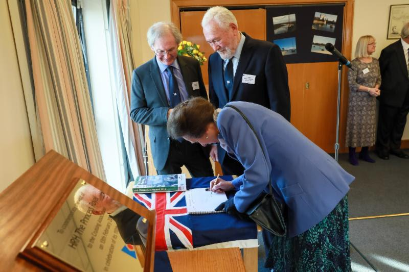 The Princess Royal signs the Visitors Book having unveiled a plaque to mark the CA's 110th Anniversary, accompanied by CA President Julian Dussek and CA Patron Sir Robin Knox-Johnston. - photo © Duncan Smith Photography