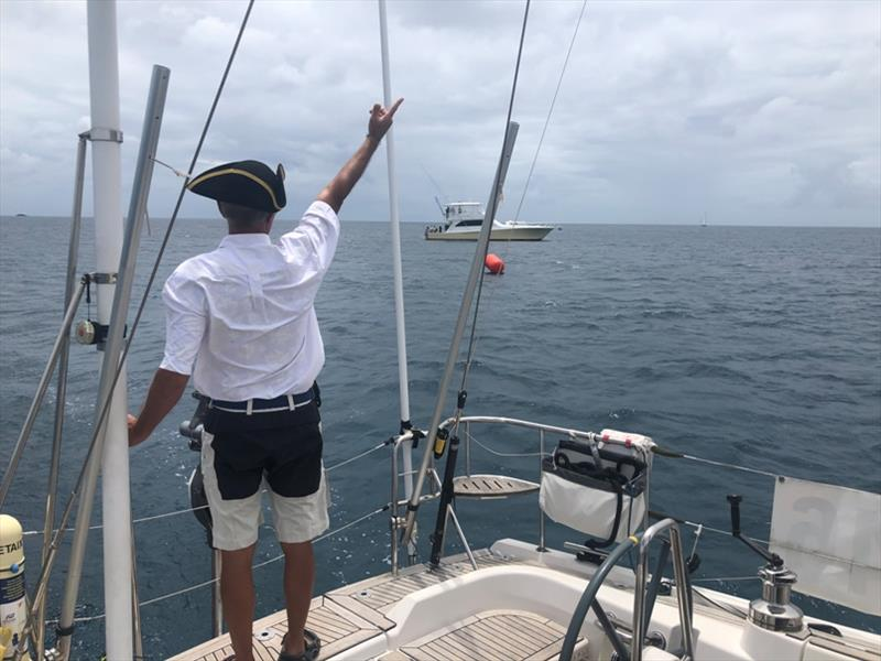 Saluting the committee boat, 'Reel Extreme' Denis from yacht Pretaixte - photo © World Cruising Club