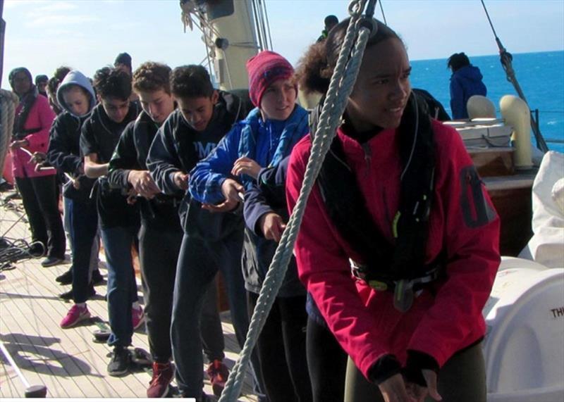 All pulling together aboard the Spirit of Bermuda - photo © Bermuda Sloop Foundation