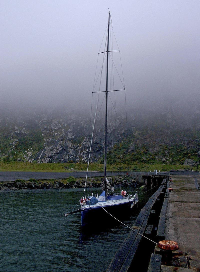 The Open 66 Gusto sits below Stanley's famous basalt massif, The Nut (and plenty of fog). - photo © John Curnow