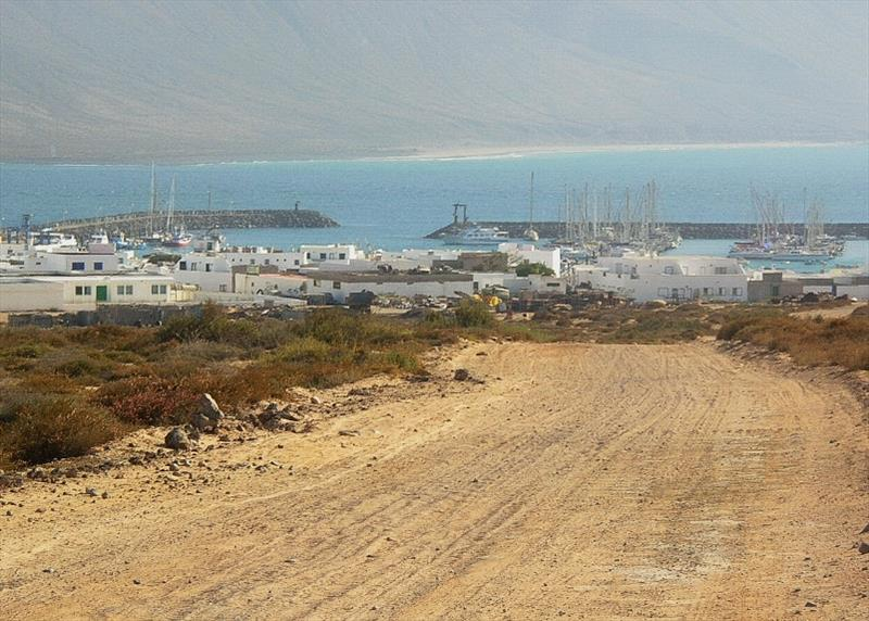 Graciosa Town and Marina with Lanzarote in background - photo © Hugh & Heather Bacon