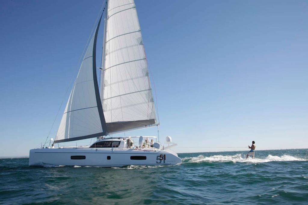 Outremer 51 with wakeboarder in tow - photo © Ross Southam-Walker www.multihullcentral.com