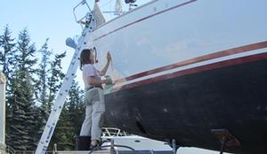 Polishing the topsides, and we all have to face it - Jeanne Socrates, oldest ever non-stop female solo circumnavigator, at work on Nereida photo copyright  SW taken at  and featuring the  class