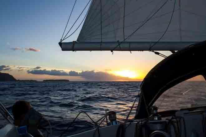 Huahine bound. Setting sails at sunset for our overnight passage. © Voyage of Te Mana